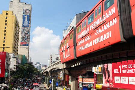 KUALA LUMPUR, MALAYSIA - 17th July 2017: Train of KL Monorail in the Bukit Bintang district of Kuala Lumpur over busy city background Editorial