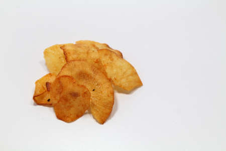 A tapioca chips snack coated with honey flavor isolated white background