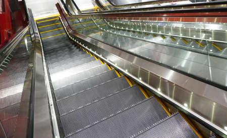 Electric Escalator in metro. Moving down staircase 写真素材