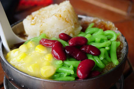 Cendol Desert. Asian favourite iced dessert of rice flour and pandanus jelly with coconut milk and palm sugar