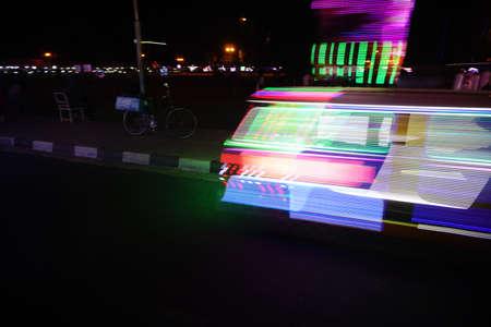 A beautiful Slow Shutter light decorative car or Bechak at Alun Alun Yogjakarta. Light Painting Concept. Redactioneel