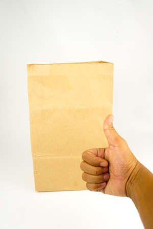 Paper bag with hand show good sign, Recycle environment friendly concept. Copy Space