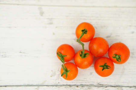 Tomato on a wooden background. Selective Focus. Healthy Lifestyle Food. Copy Space