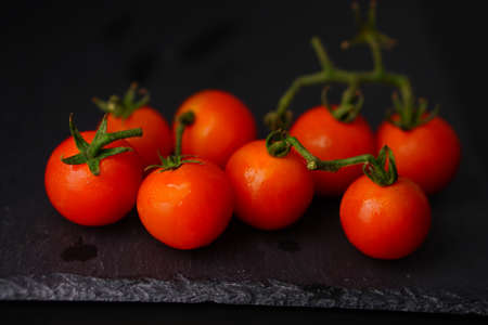 Tomato on slate plate over dark background. Selective Focus, Healthy Lifestyle Food Stock fotó