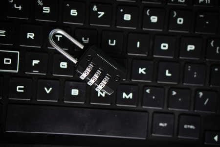 Number Padlock on Black keyboard. Internet security Breach concept