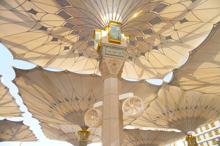 Big umbrella structure of al masjid al nabawi from the holy land and beautiful building structure madinah saudi arabia Stock Photo