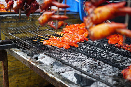 Delicious Hot Spicy Grilled Chicken Wings on a Local Market for sale 스톡 콘텐츠