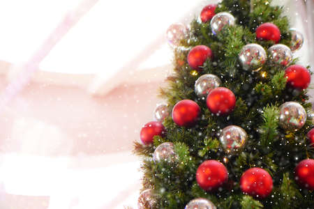 Close up Christmas tree decorated with silver and red Christmas balls. Snow Effect Soft Focus. Copy Space Concept