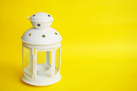 Decoratice Ornamental Arabic Muslim Lamp Lanter for Ramadhan over bright yellow background. Copy Space Concept