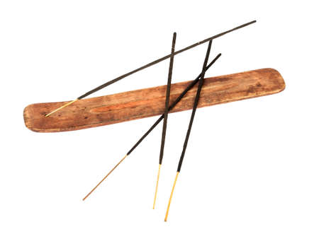 Incense stick in wooden holder isolated on white background Stock Photo