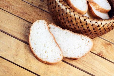 breadbasket: Two slices of bread near wicker breadbasket Stock Photo