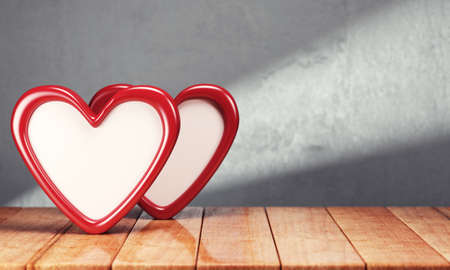 desk toy: Two hearts on wooden table over gray background. 3d rendering
