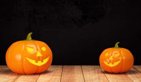 Halloween pumpkin on wooden table on dark background. 3d rendering Stock Photo