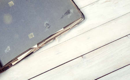 Old opened photo album on wooden background