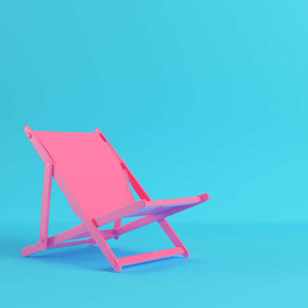 Pink beach chair on bright blue background in pastel colors. Minimalism concept. 3d render Stock Photo