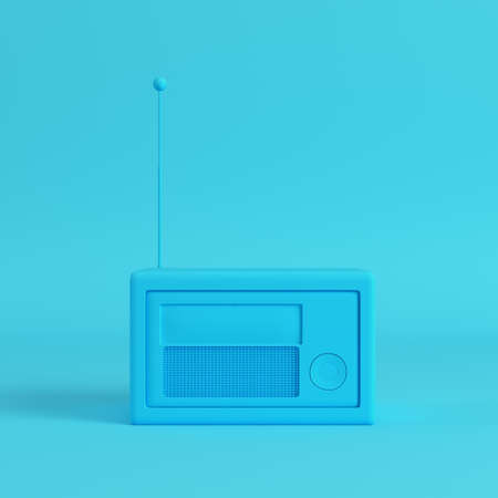 Retro styled radio on bright blue background in pastel colors.