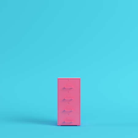 Pink filing cabinet on bright blue background in pastel colors. Minimalism concept. 3d render Stock Photo
