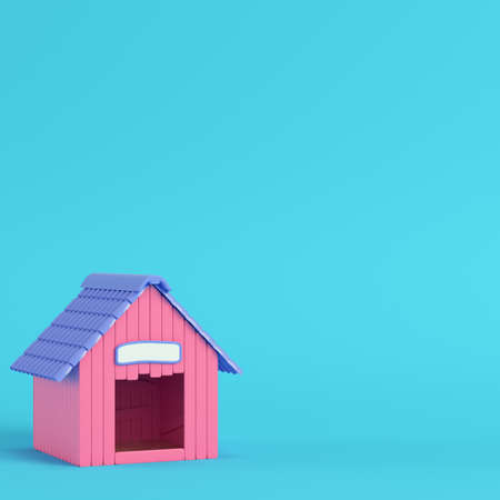 Pink doghouse on bright blue background in pastel colors. Minimalism concept. 3d render Stock Photo