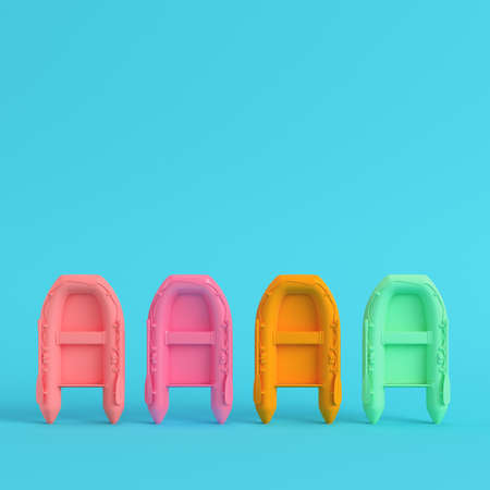 Four colorful inflatable boats on bright blue background in pastel colors. Minimalism concept. 3d render