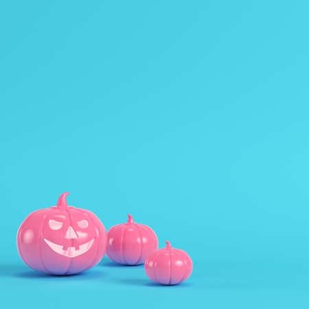 Pink halloween pumpkin, jack o lantern on bright blue background in pastel colors. Minimalism concept. 3d render