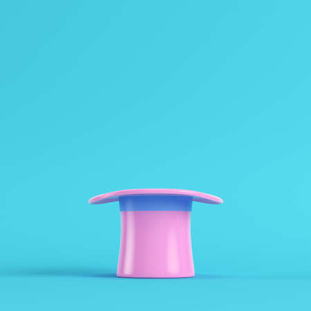 Pink top hat on bright blue background in pastel colors. Minimalism concept. 3d render Stock Photo
