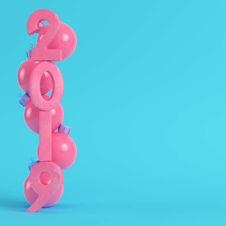 Pink new year 2019 figures with christmas balls on bright blue background in pastel colors. Minimalism concept. 3d render