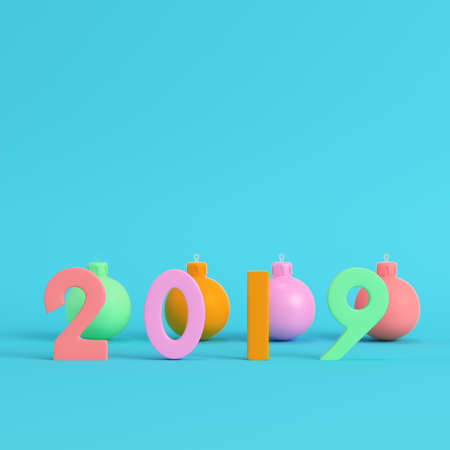 Four colorful new year 2019 figures with christmas balls on bright blue background in pastel colors. Minimalism concept. 3d render