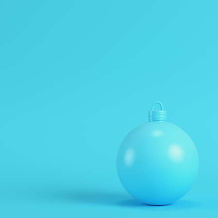 Christmas ball on bright blue background in pastel colors. Minimalism concept. 3d render Stock Photo