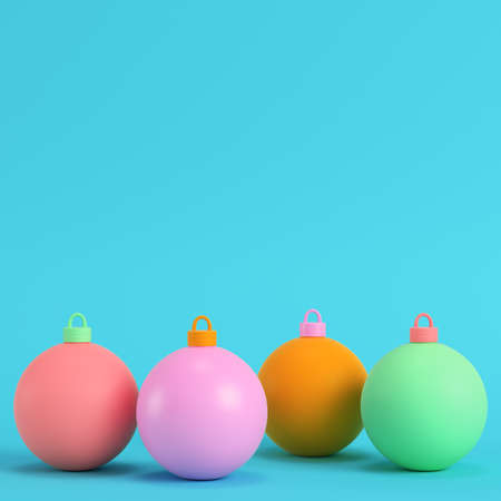 Four colorful christmas ball on bright blue background in pastel colors. Minimalism concept. 3d render