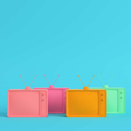 Four colorful retro styled tvs on bright blue background in pastel colors. Minimalism concept. 3d render Stock Photo