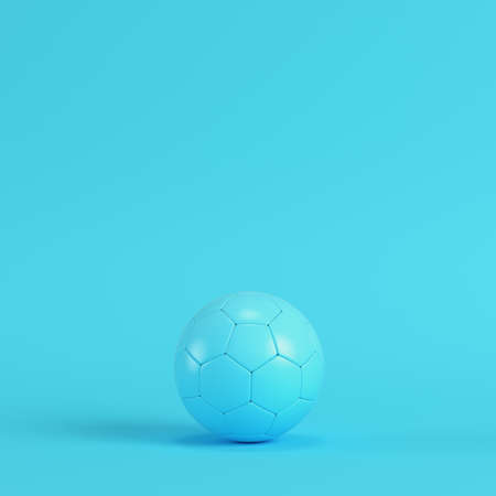 Soccer ball on bright blue background in pastel colors. Minimalism concept. 3d render Stock Photo