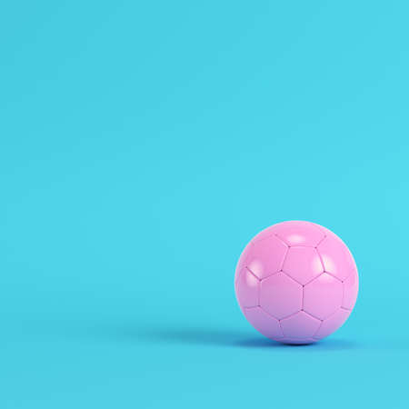 Pink soccer ball on bright blue background in pastel colors. Minimalism concept. 3d render
