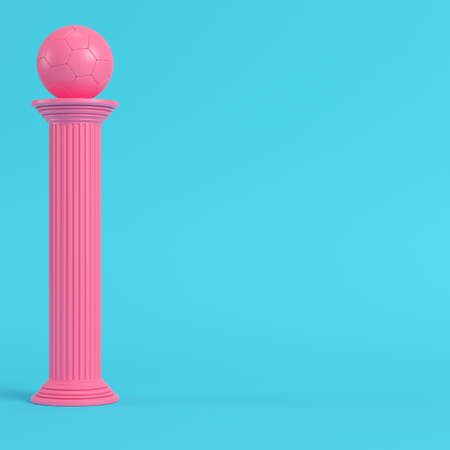 Pink column with soccer ball on bright blue background in pastel colors. Minimalism concept. 3d render Stock Photo
