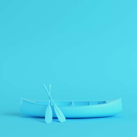 Canoe with paddles on bright blue background in pastel colors. Minimalism concept. 3d render Stock Photo