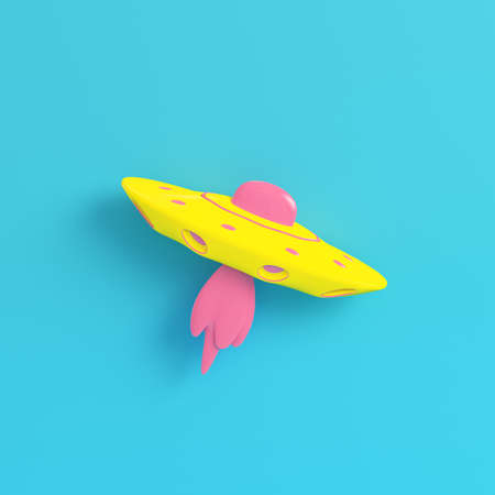 Yellow ufo or alien starship on bright blue background in pastel colors. Minimalism concept. 3d render