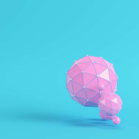 Pink low poly abstract spheres on bright blue background in pastel colors. Minimalism concept. 3d render
