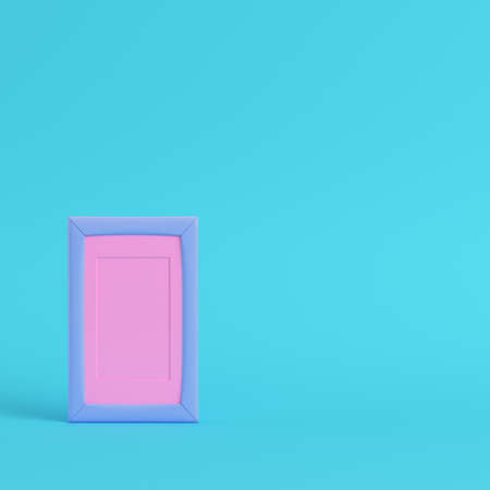 Pink blank frame on bright blue background in pastel colors. Minimalism concept. 3d render