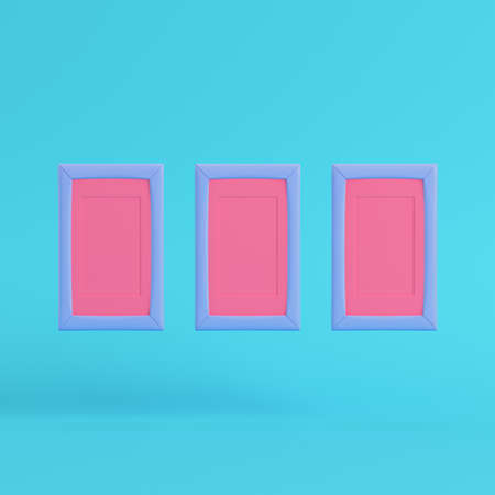 Pink blank frames on bright blue background in pastel colors. Minimalism concept. 3d render