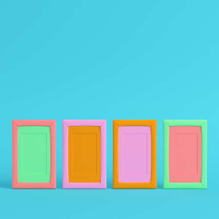 Four colorful blank frames on bright blue background in pastel colors. Minimalism concept. 3d render