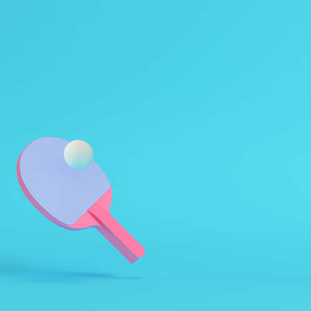 Pink table tennis racket with ball on bright blue background in pastel colors. Minimalism concept. 3d render