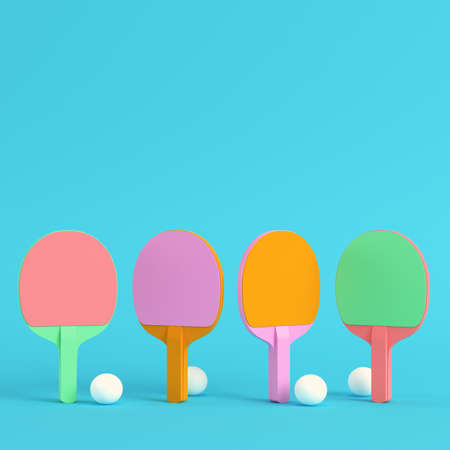 Four table tennis rackets with balls on bright blue background in pastel colors. Minimalism concept. 3d render
