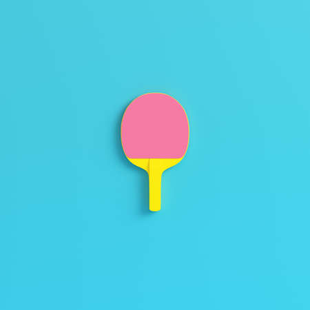 Yellow table tennis  racket on bright blue background in pastel colors. Minimalism concept. 3d render
