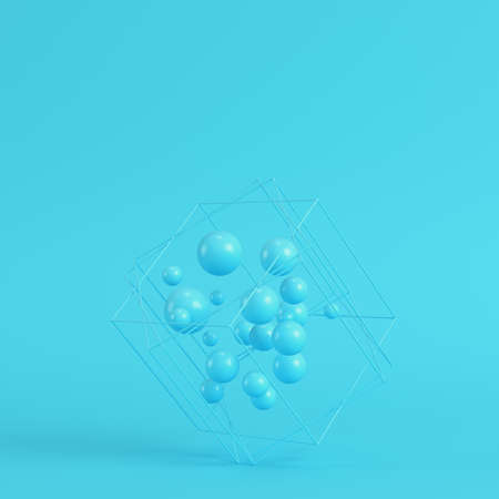 Abstract spheres in wire box on bright blue background in pastel colors. Minimalism concept. 3d render Imagens