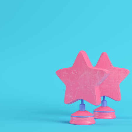 Stars with stand on bright blue background in pastel colors. Minimalism concept. 3d render