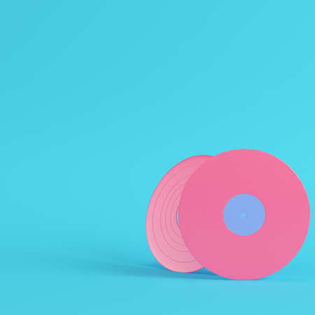 Vinyl records on bright blue background in pastel colors. Minimalism concept. 3d render Imagens