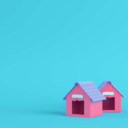 Pink doghouses on bright blue background in pastel colors. Minimalism concept. 3d render Imagens
