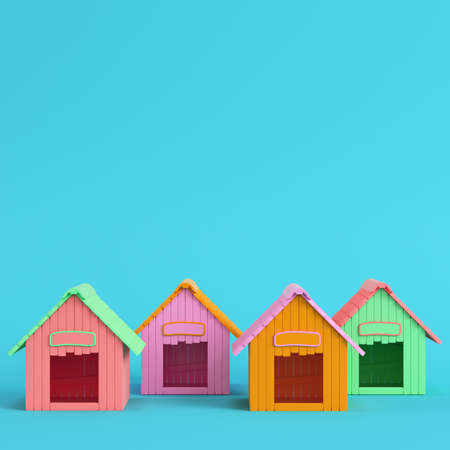 Four colorful doghouses on bright blue background in pastel colors. Minimalism concept. 3d render