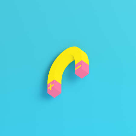 Yellow magnet on bright blue background in pastel colors. Minimalism concept. 3d render Фото со стока