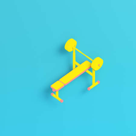 Yellow barbell with bench on bright blue background in pastel colors. Minimalism concept. 3d render