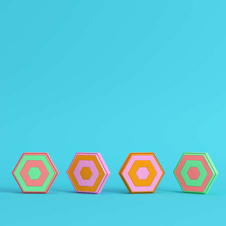 Four colorful abstract hexagons on bright blue background in pastel colors. Minimalism concept. 3d render